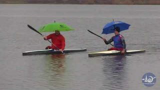 Paddlers with umbrella
